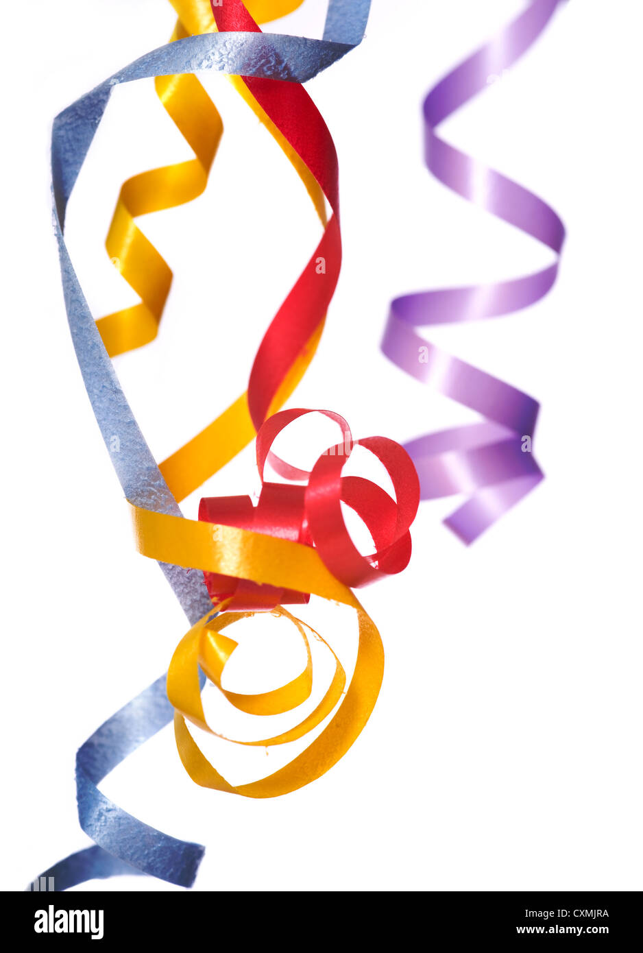 Colorful, curly, ribbon streamers on a white background with copy space - Stock Image