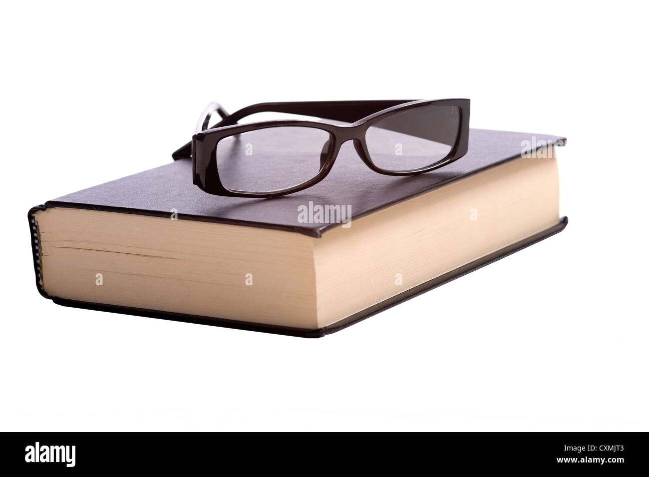 e1f968e5e2 A pair of fashionable reading glasses on top of a black book on a white  background