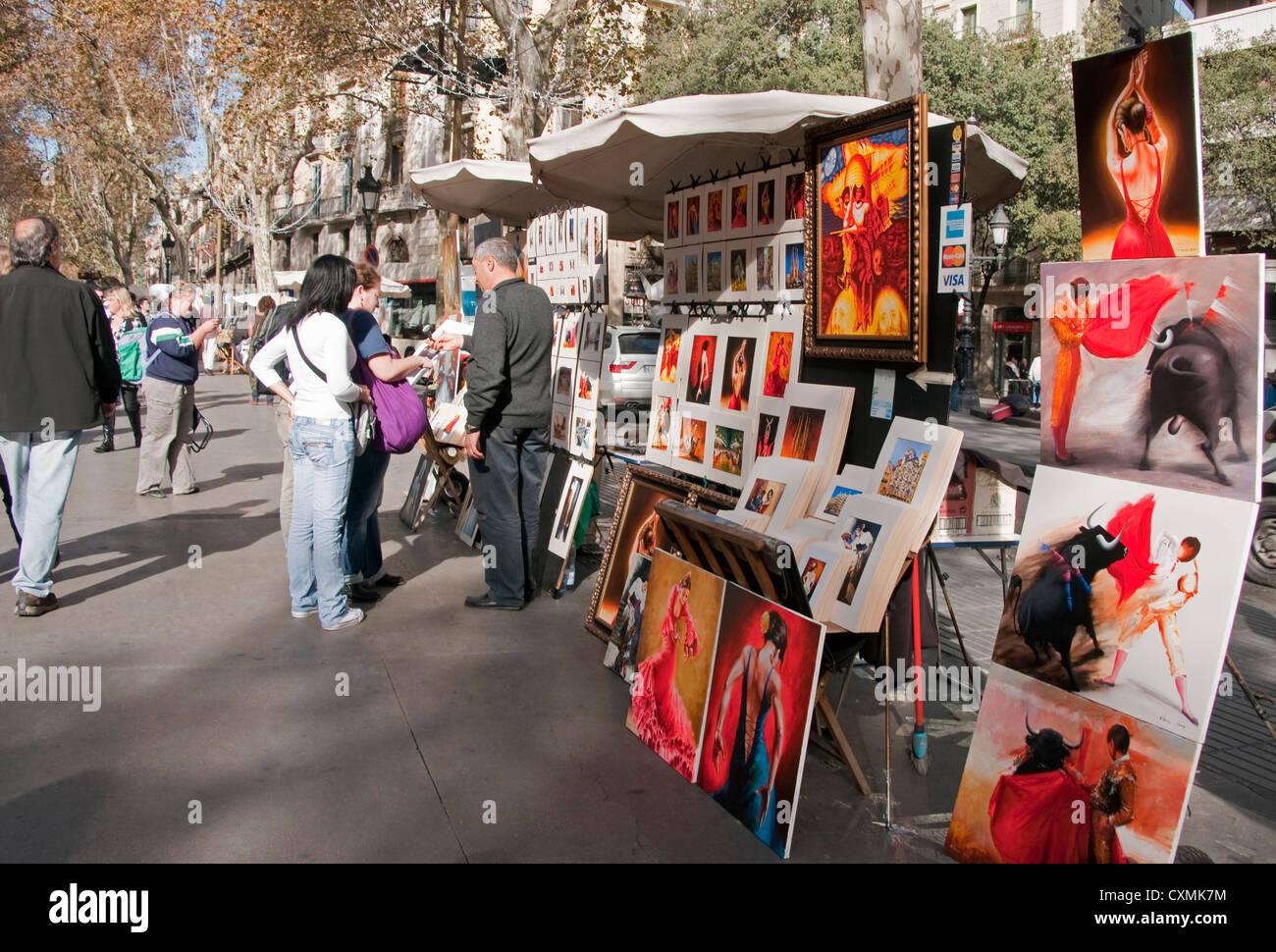 Artist on Las Ramblas in Barcelona selling paintings - Stock Image
