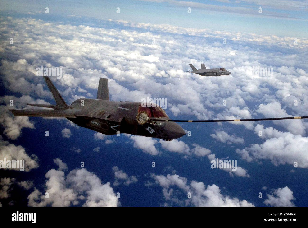 Two US Marine Corps F-35B Joint Strike Fighters conduct the first aerial refueling of its kind with a KC-130J Hercules - Stock Image