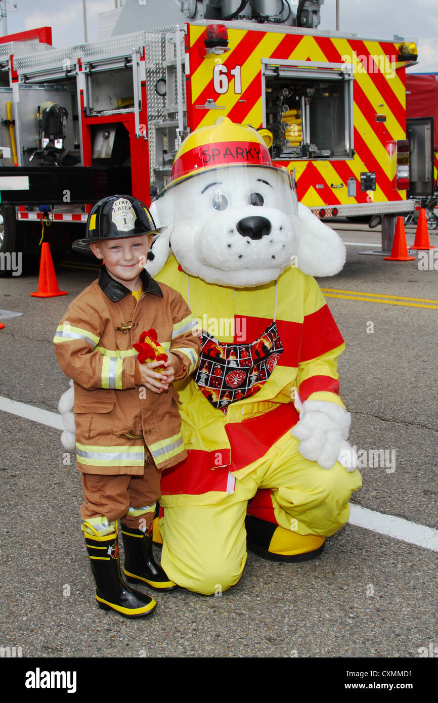 Young Boy Dressed In Fire Suit Standing With Sparky The Dog Beavercreek Popcorn Festival