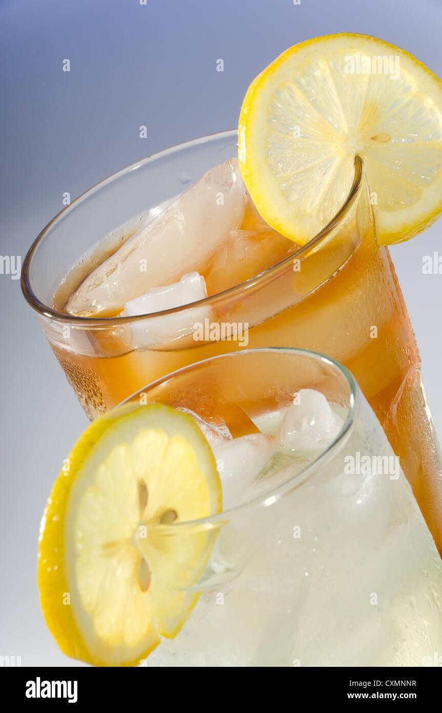 Summertime drinks including iced tea and lemonade wih a lemon slice - Stock Image