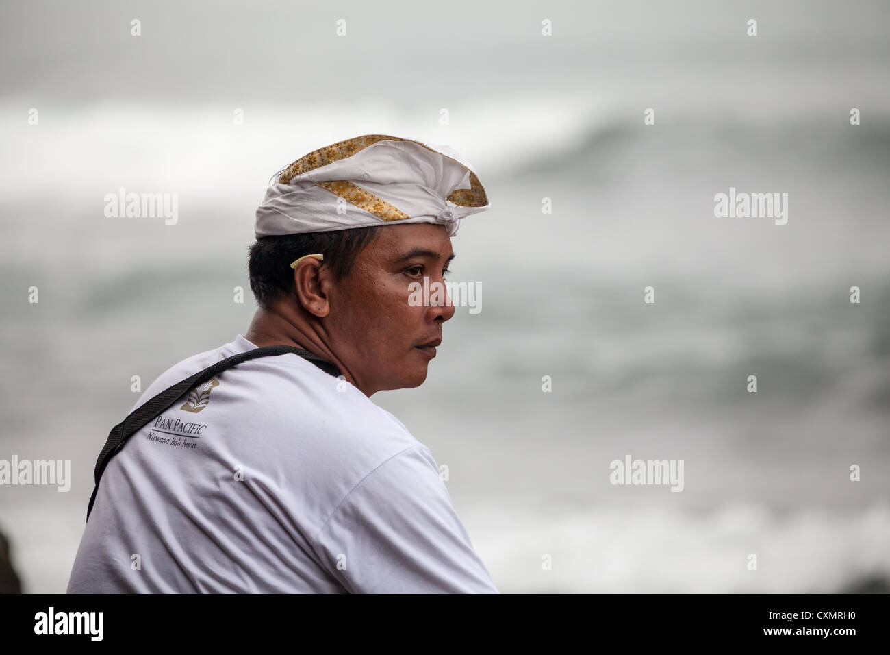 Balinese in traditional Clothes at the Hindu Temple Pura Tanahlot on Bali - Stock Image