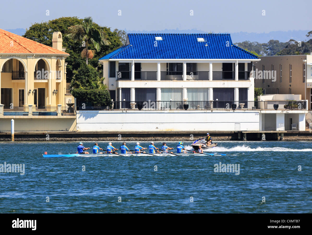 Water police clear the course at University river regatta rowing for trophies Surfers Paradise Queensland - Stock Image