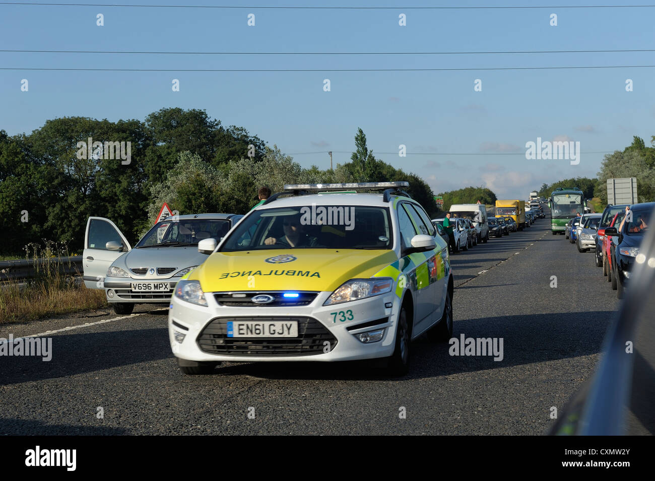 paramedic ambulance response vehicle rushing to a road traffic accident england uk - Stock Image