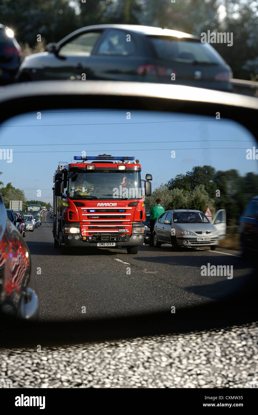 fire engine on its way to a road traffic accident seen through a car