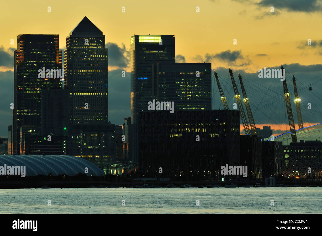 London Docklands skyline with o2 Arena and Canary Wharf, early evening - Stock Image