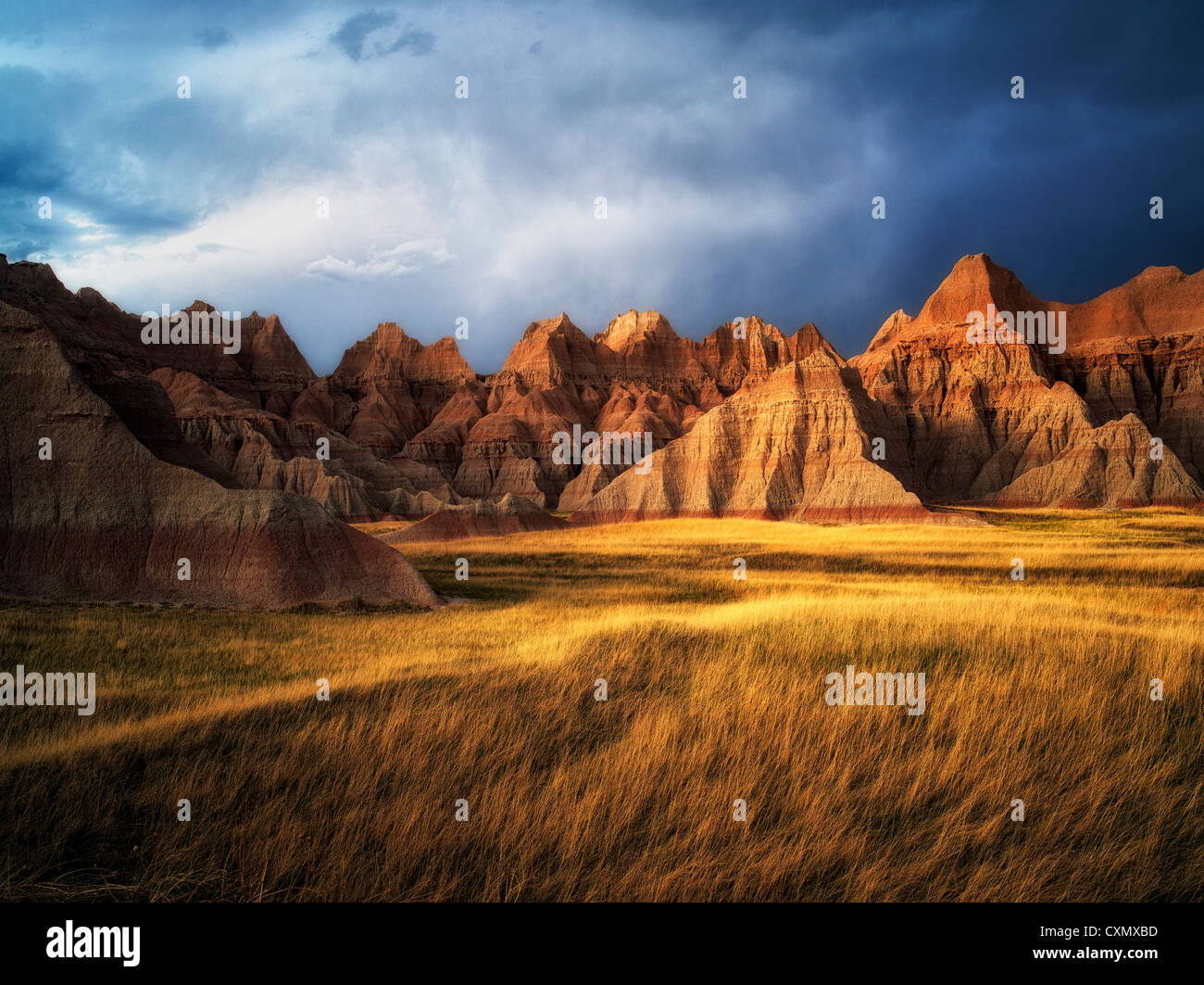 Grass meadow and colorful rocks. Badlands National Park, South Dakota. - Stock Image