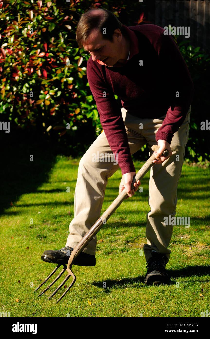 Aeration ,Lawn Care.Gardening. Stock Photo