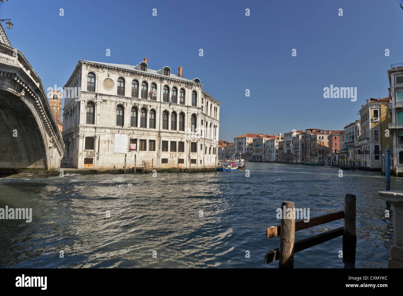 Magistrate building by the Grand canal and Rialto bridge, Venice, Italy. - Stock Image