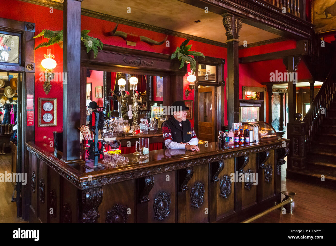 Barman in the saloon on Main Street, '1880 Town' western attraction, Murdo, South Dakota, USA - Stock Image