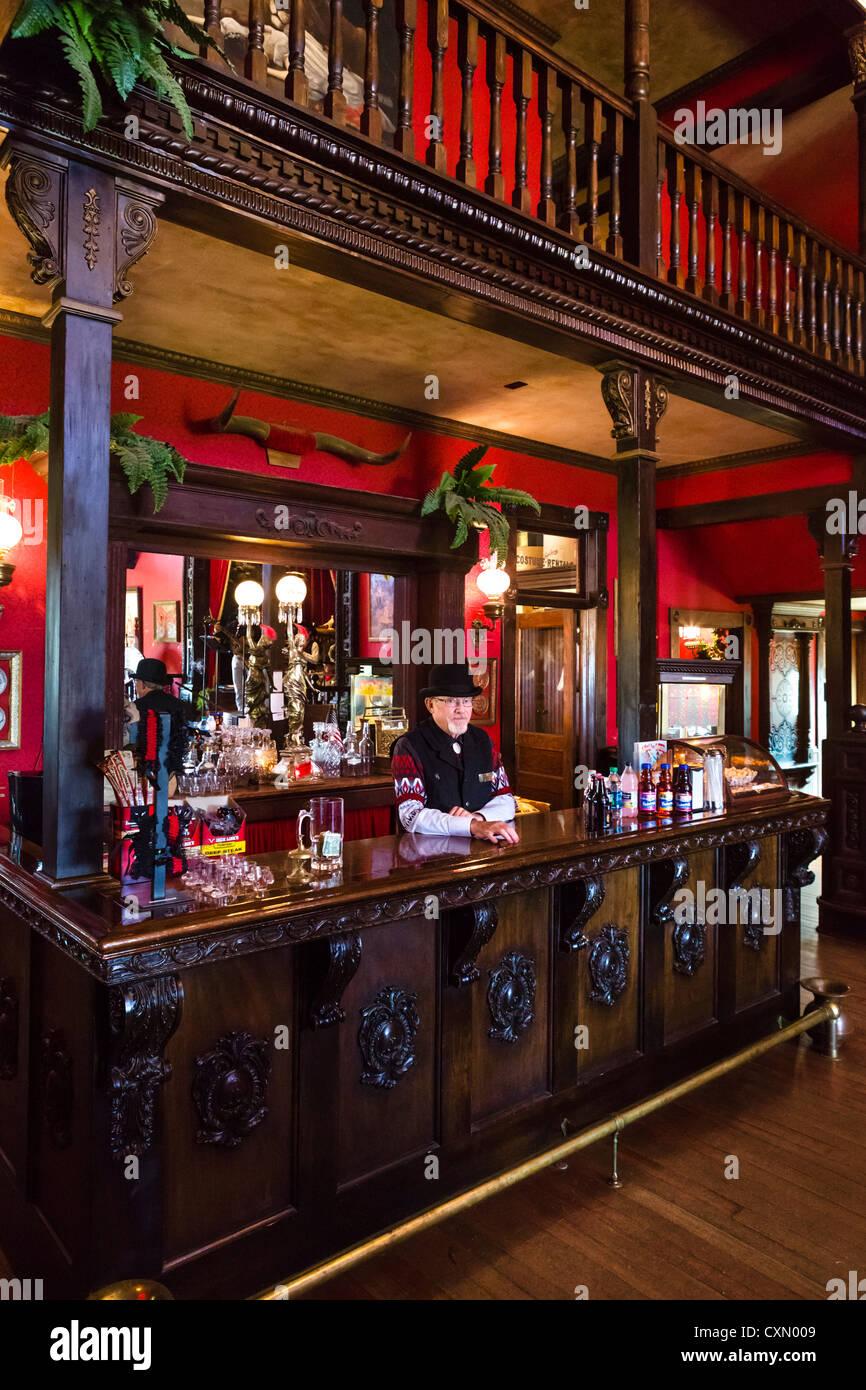 Barman in the saloon on Main Street, '1880 Town' western attractio, Murdo, South Dakota, USA - Stock Image