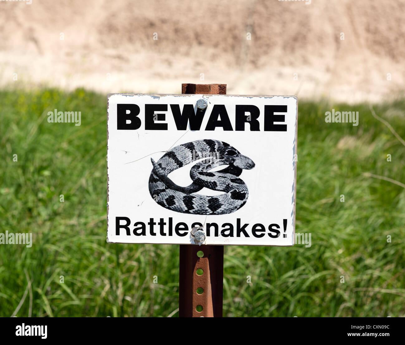 Beware of Rattlesnakes sign, Badlands National Park, South Dakota, USA Stock Photo