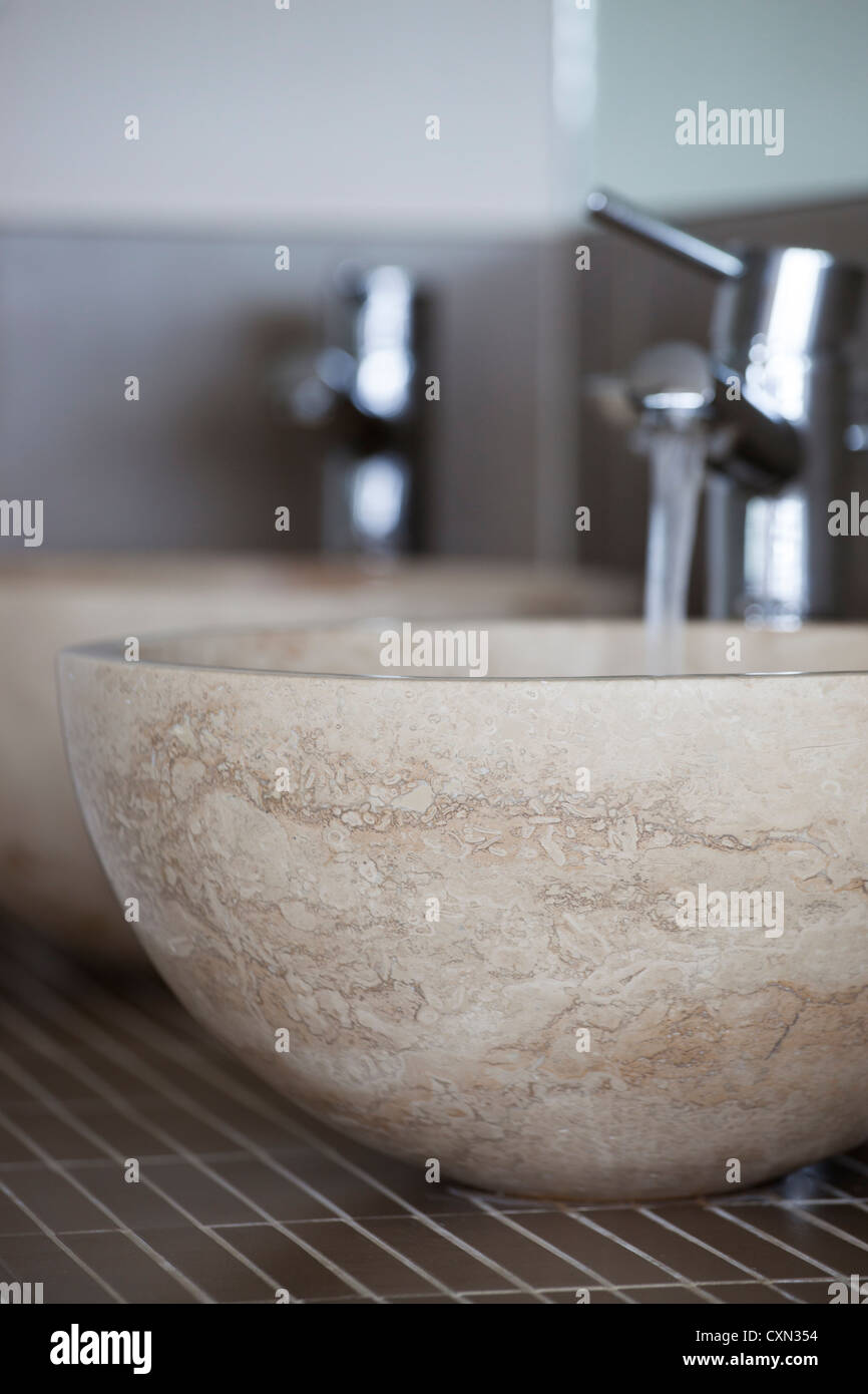 Modern bathroom sink units made of stone - Stock Image