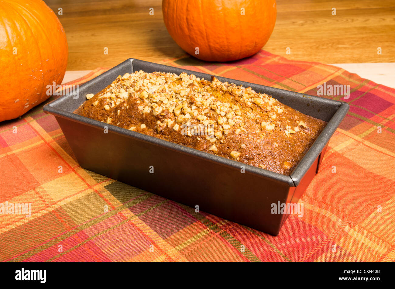 A pan of fresh pumpkin bread just out of the oven - Stock Image