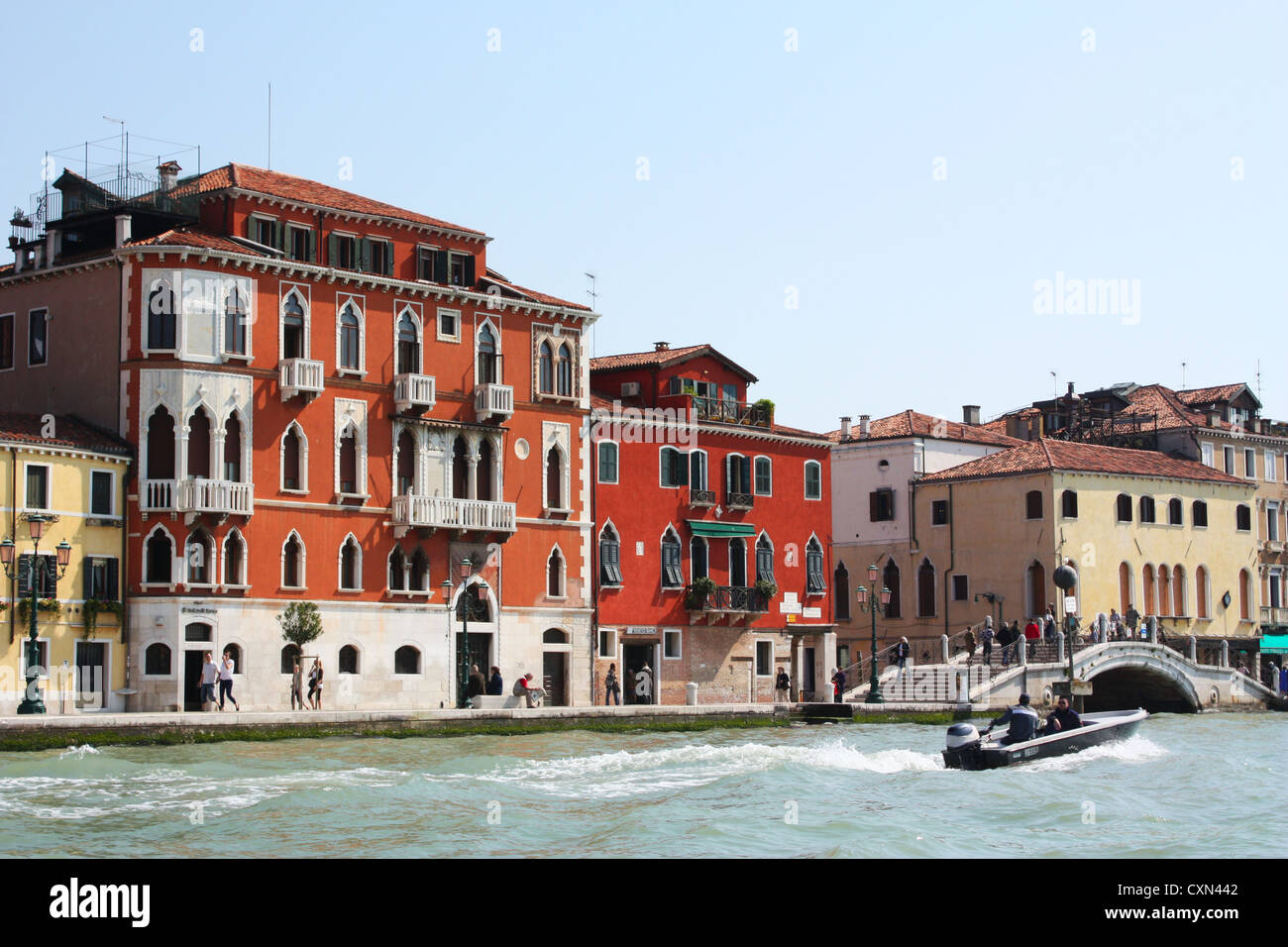 Buildings , bridge and a boat in Grand canal in Venice, Italy Stock Photo