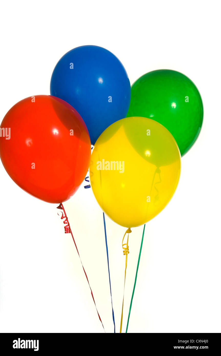 brightly colored balloon bouquet on white background stock photo