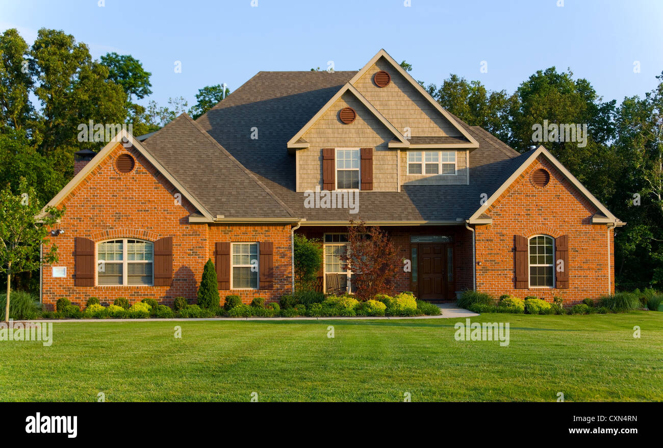Beautiful house or property late in the afternoon against blue sky - Stock Image