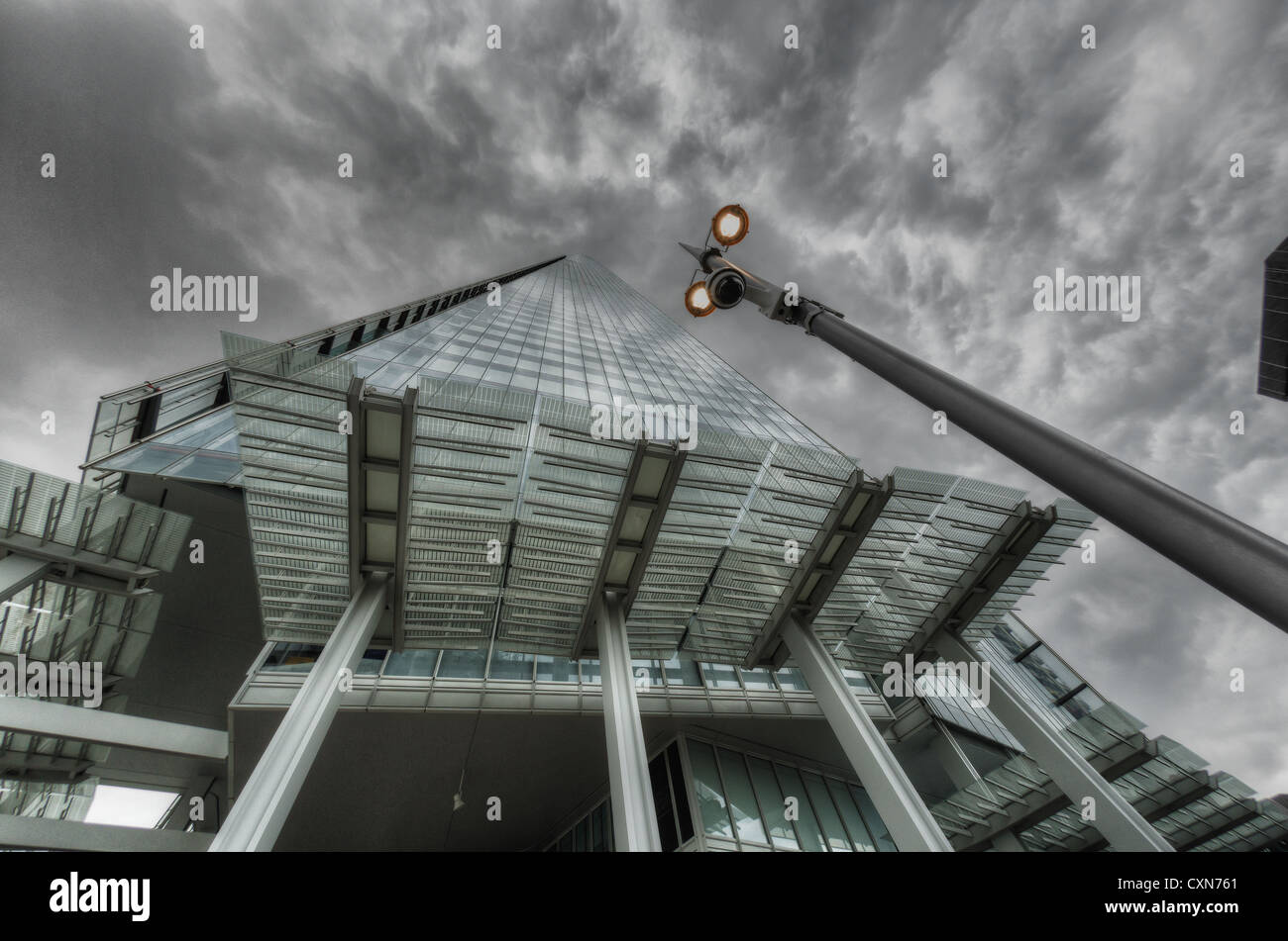 The Shard building close up view of modern architectural construction from ground level looking up into the cloud - Stock Image