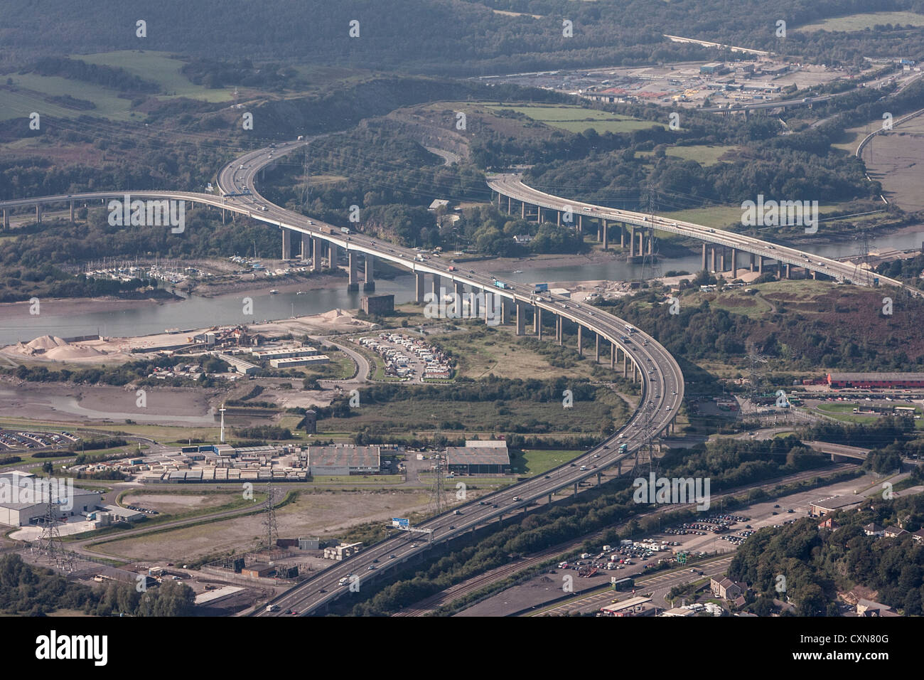 An aerial view of the new (left) and old (right) Briton Ferry Bridges spanning the river Neath between Port Talbot Stock Photo