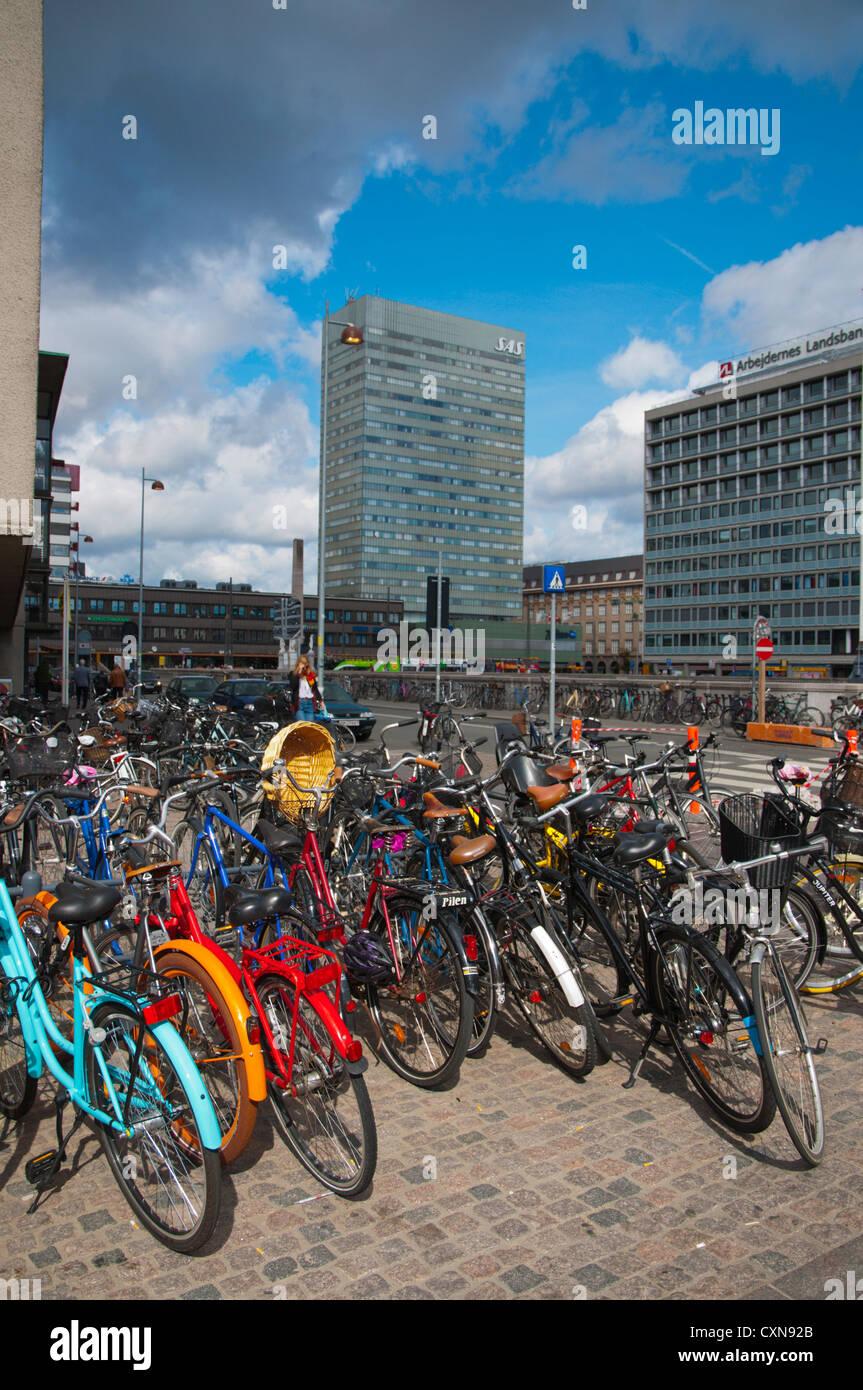 Bicycles parked at Banegårdpladsen square outside central railway station Copenhagen Denmark Europe - Stock Image