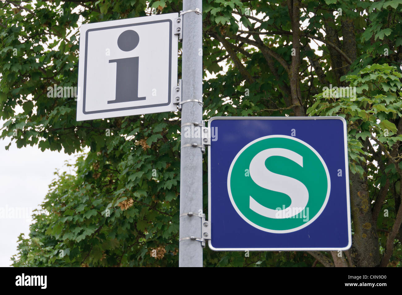 German or Swiss S-Bahn, commuter passenger train, train station sign and information point sign signage post - Stock Image