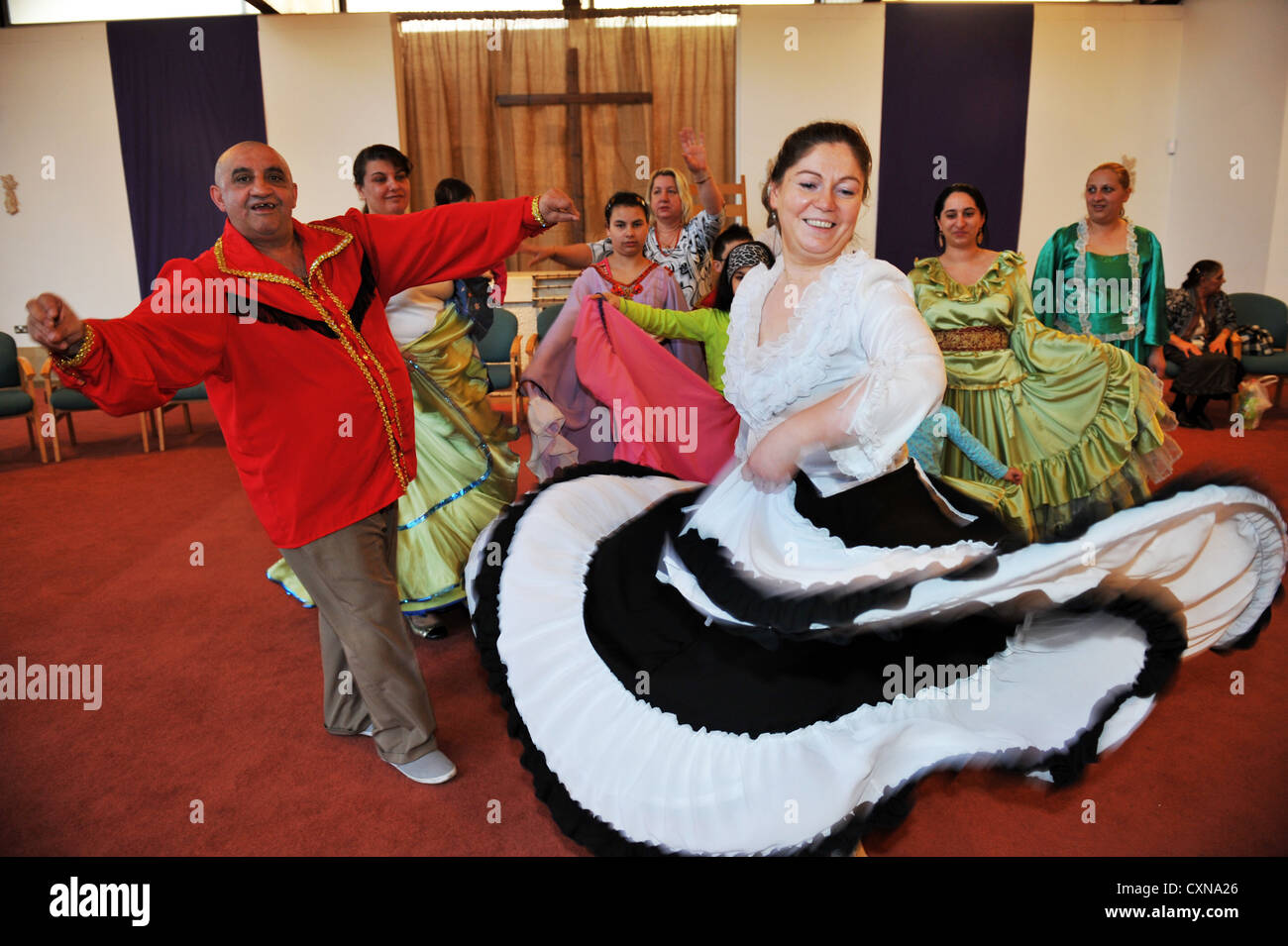 Roma Community dancing in traditional clothing now living in Bradford UK - Stock Image