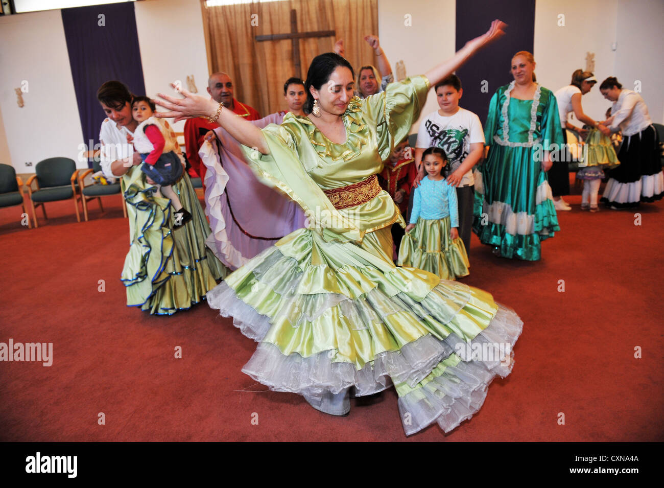Roma Community dancing at a Community Centre in traditional clothing now living in Bradford UK - Stock Image
