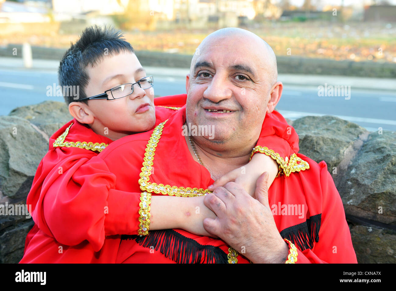 Polish Roma father and son in traditional clothing, Bradford UK - Stock Image