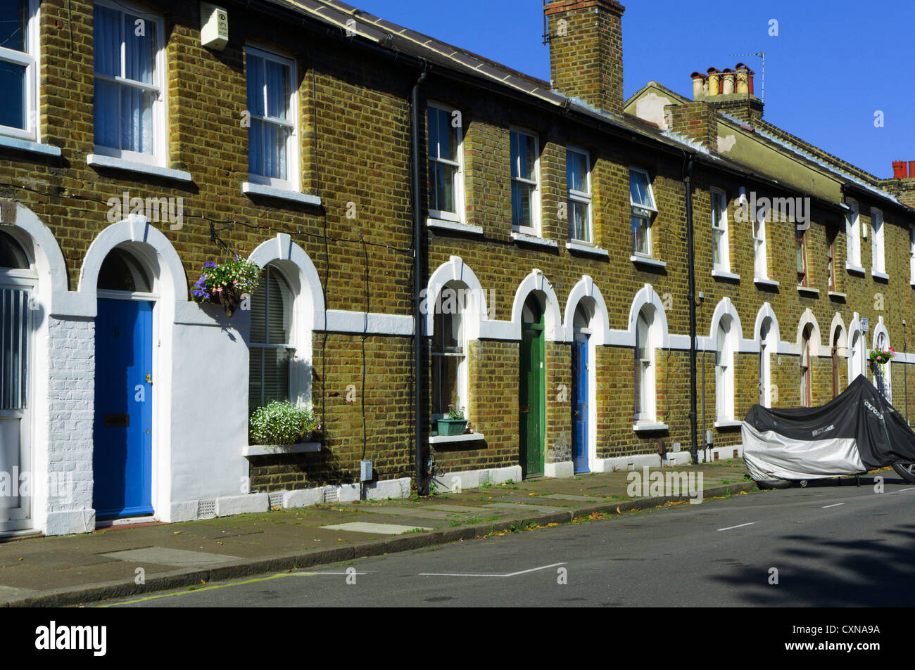 A suburban street of small nineteenth century terraced houses in Bromley, South London. - Stock Image