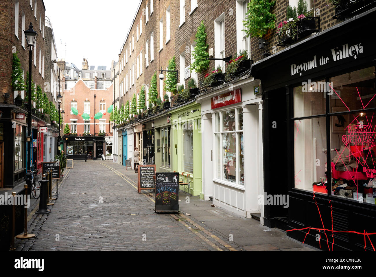 Boutiques and fashion shops in Newburgh Street, near Carnaby Street, London UK - Stock Image