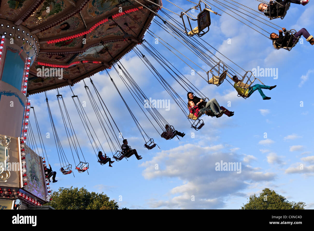A Carousel spins fairgoers sideways at   Nottingham's  historic Goose Fair. Nottingham, UK - Stock Image