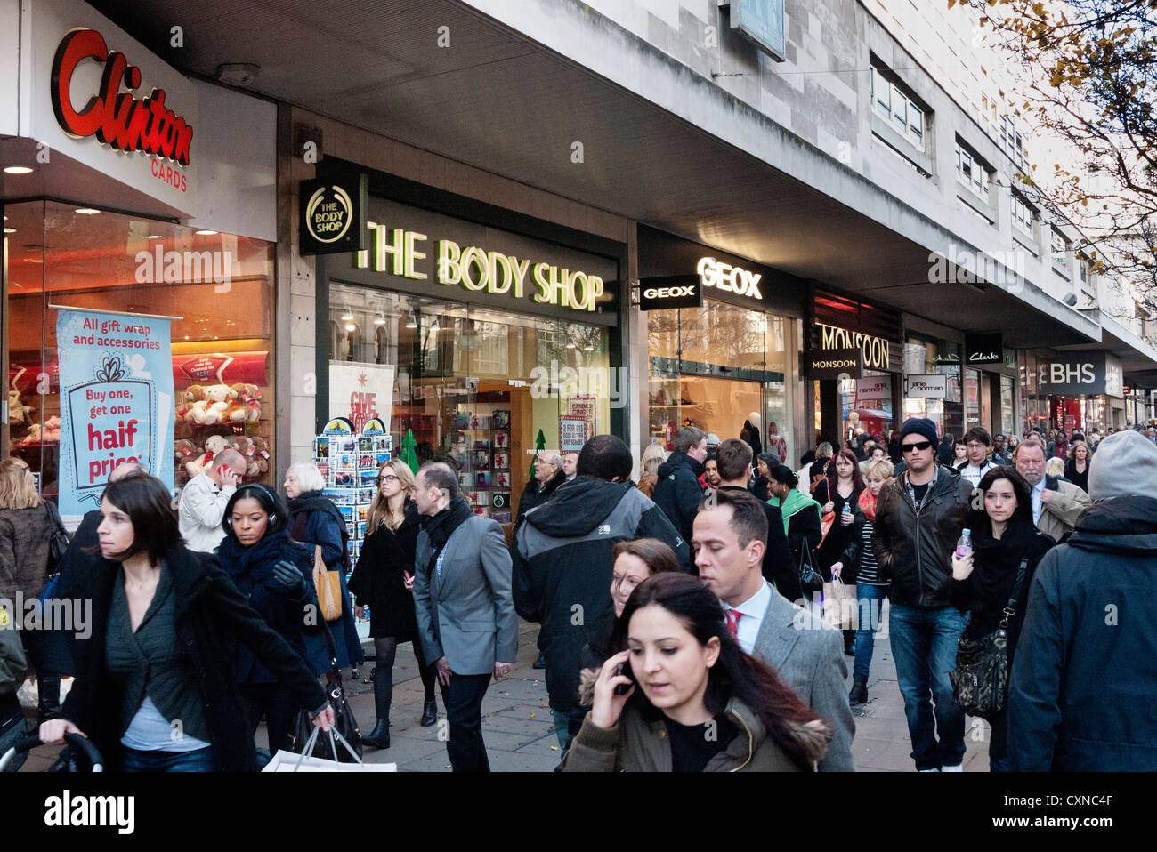 d0729300ac1 Christmas shoppers in Oxford Street, London, showing Clinton Cards, Body  Shop, Geox, Monsoon