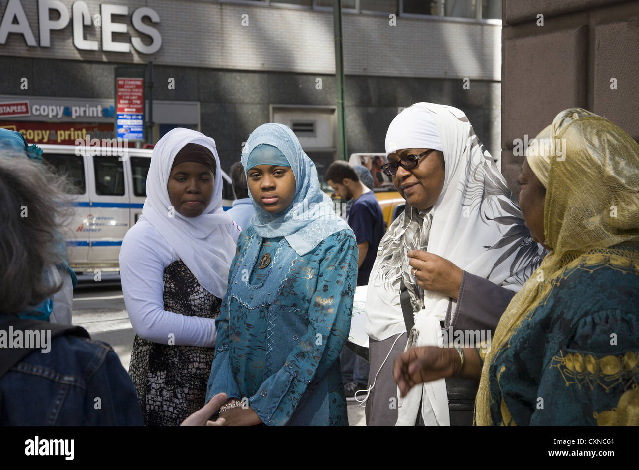 Annual Muslim American Day Parade on Madison Avenue in New York City. Traditionally dressed women wait for the parade - Stock Image