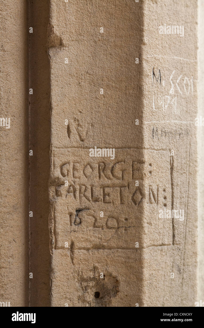 scratched names of previous students on the stone around the cloisters of winchester college 1829 - Stock Image