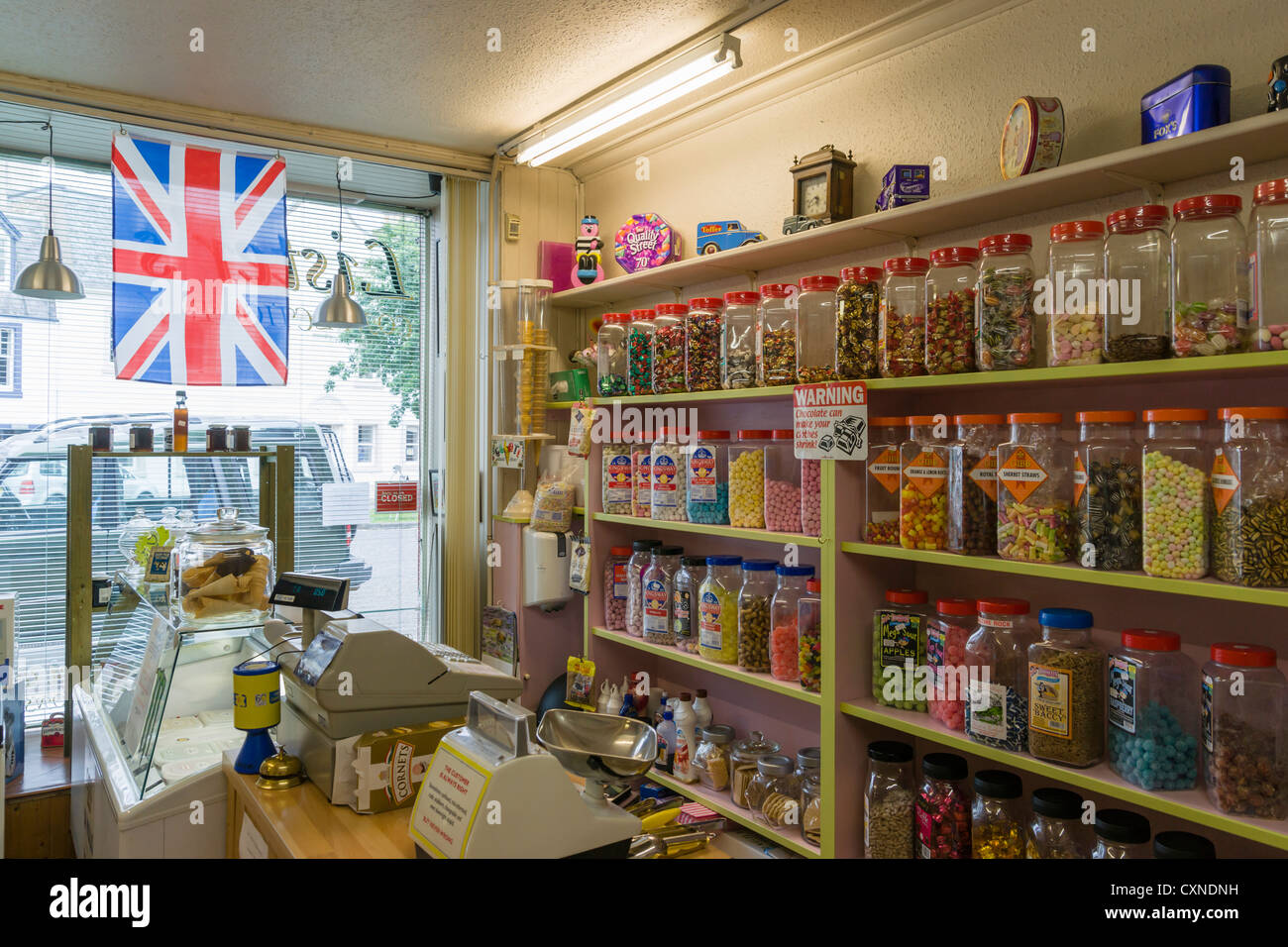 Traditional Scottish sweetie shop in East Linton, East Lothian village, jars of boiled sweets candy. - Stock Image