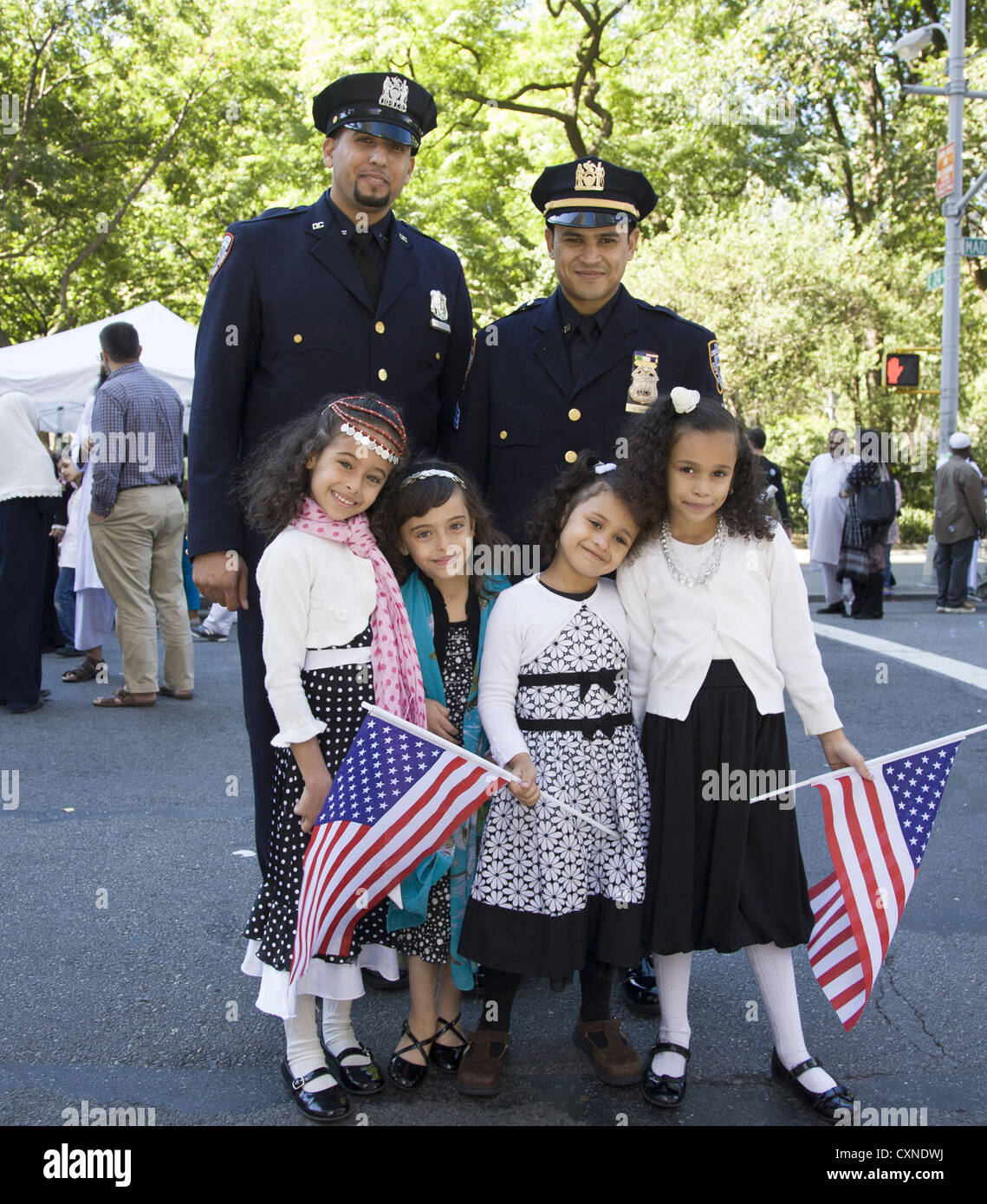 Annual Muslim American Day Parade on Madison Avenue in New York City. NYC police officers with their kids march - Stock Image