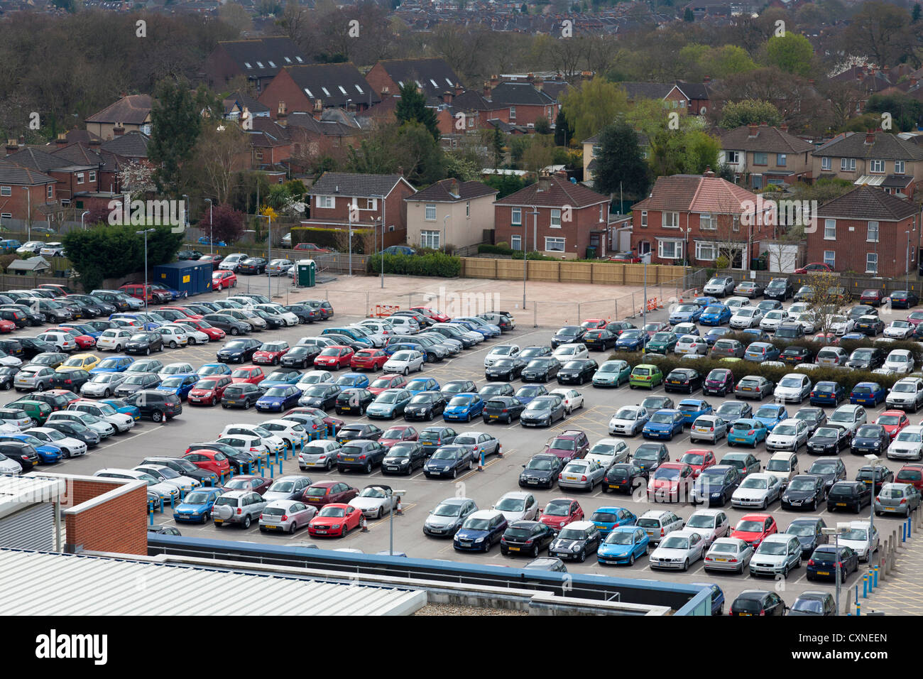 high view of busy full workplace carpark - Stock Image