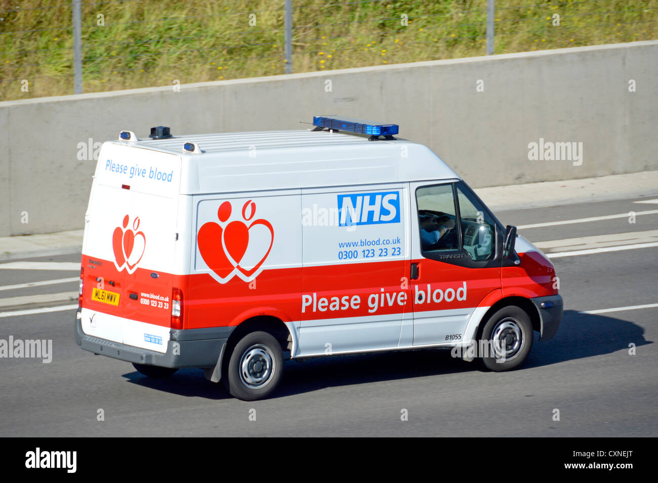 Side and back view of NHS blood and transplant service van at speed driving along M25 motorway Essex England UK - Stock Image
