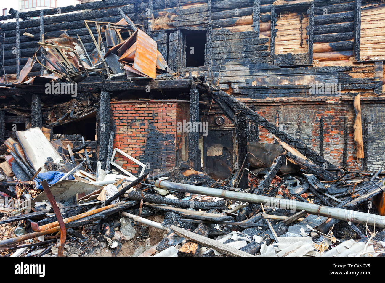 The charred ruins and remains of a burned down house - Stock Image