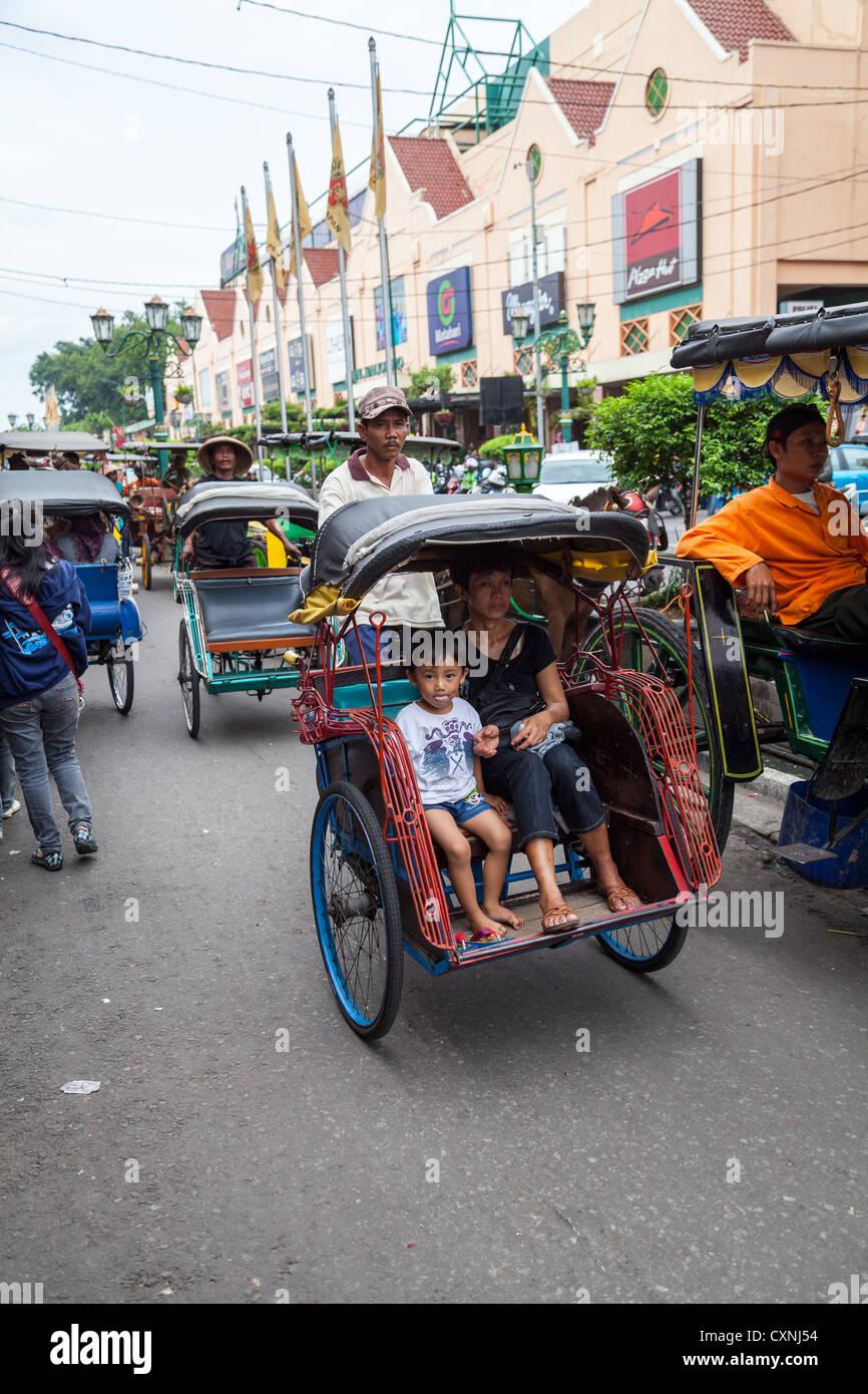 Rickshaws in Yogyakarta in Indonesia - Stock Image