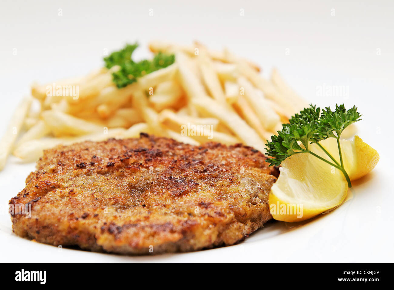 Beef cutlet / Wiener Schnitzel with french fries - Stock Image