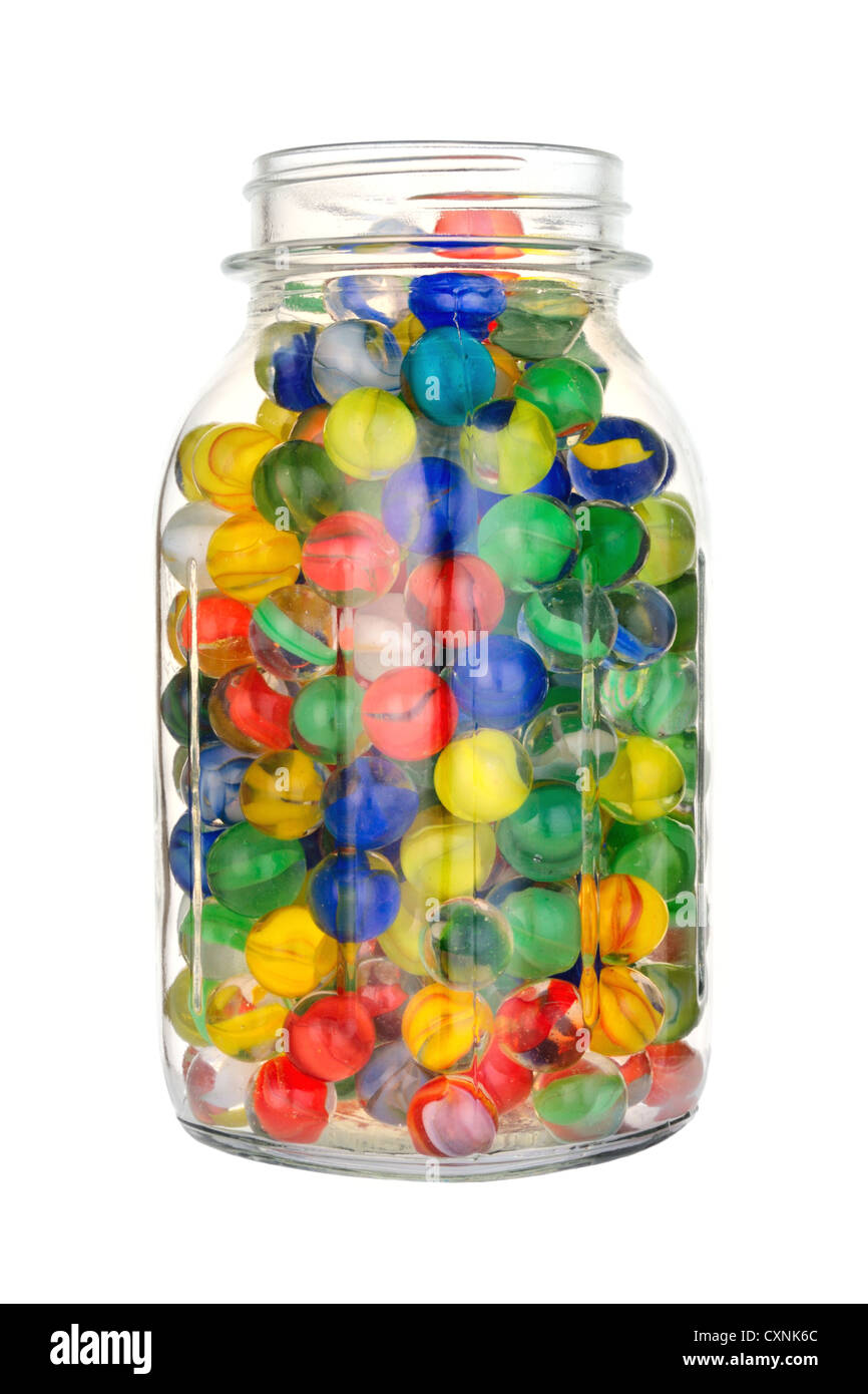 glass jar of marbles on white - Stock Image