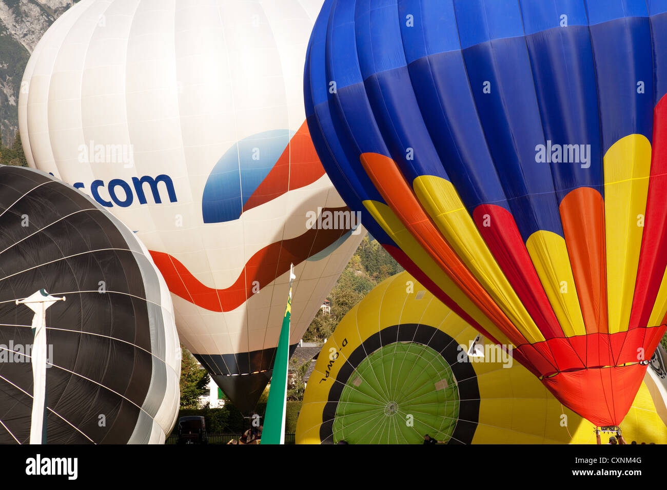 Colorful hot air balloons being inflated, Flims Switzerland Europe Stock Photo