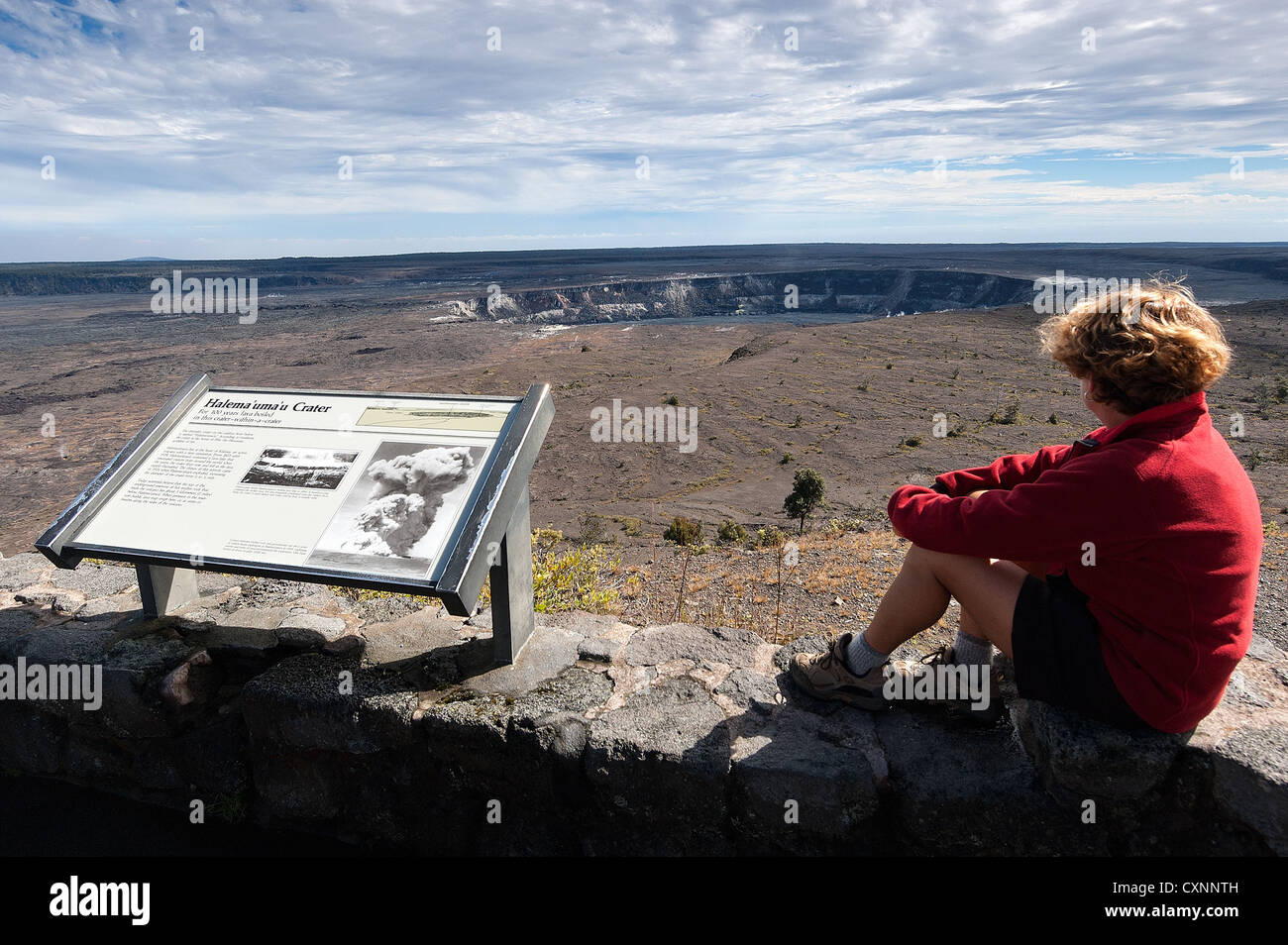 Elk284-2303 Hawaii, Big Island, Volcanoes National Park, Halema'uma'u Crater with woman visitor - Stock Image