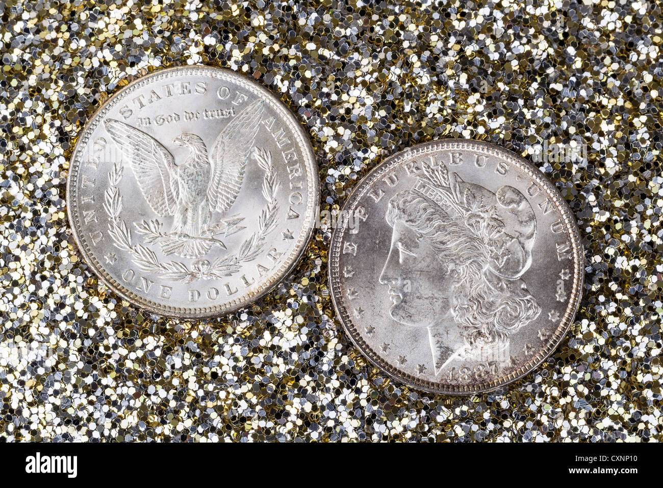 Obverse and Reverse of American Silver Dollar on Gold and Silver Glitter Background - Stock Image