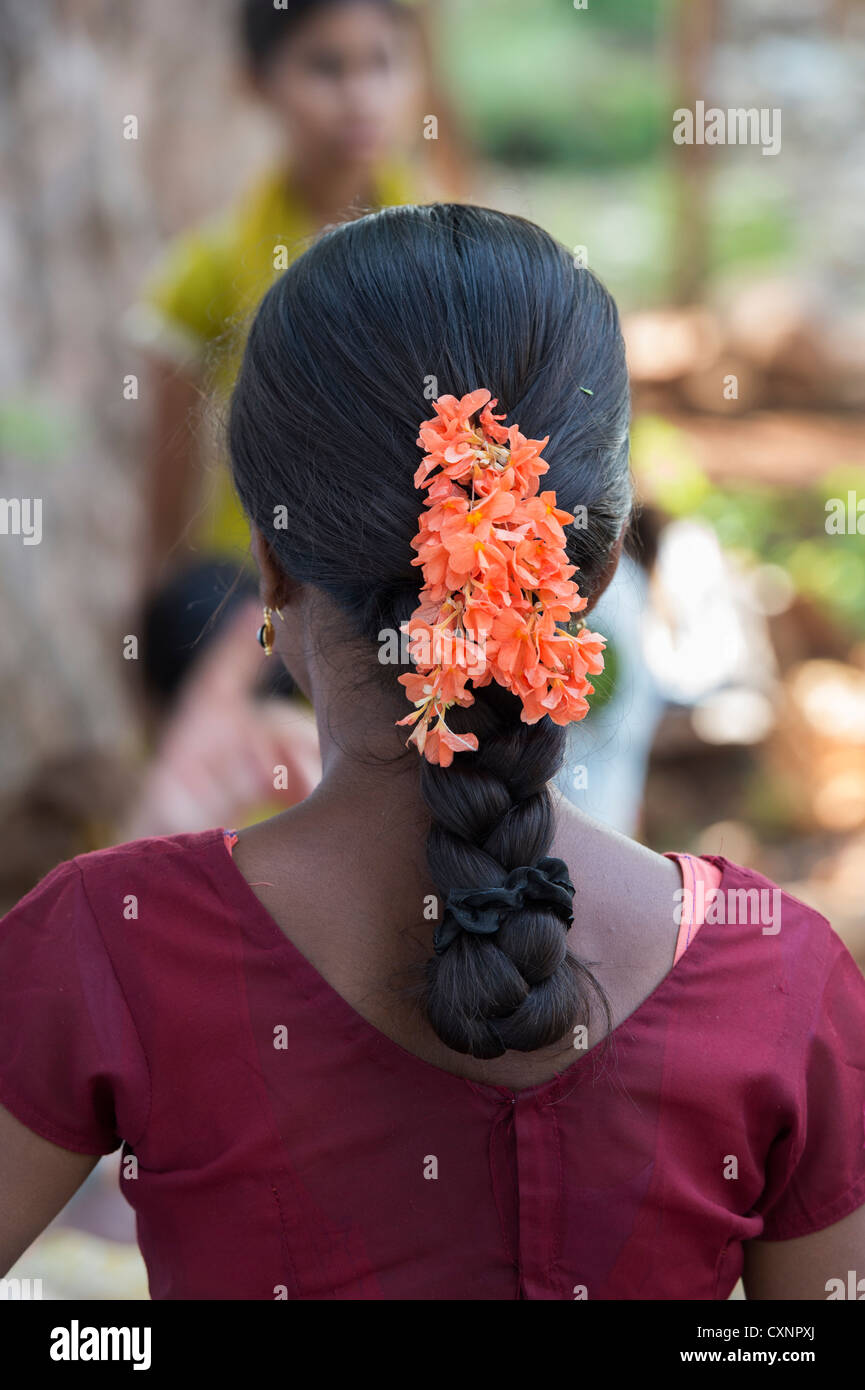 Indian Village Girls Traditional Hair Style With Plait And Flowers