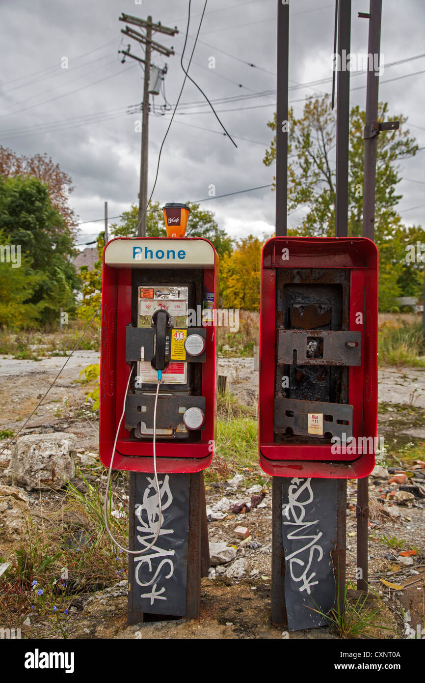 Detroit, Michigan - Coin-operated telephones, one missing, in an economically-distressed area along Grand River - Stock Image