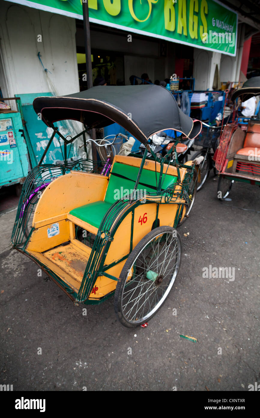 Typical Rickshaw in Yogyakarta in Indonesia - Stock Image