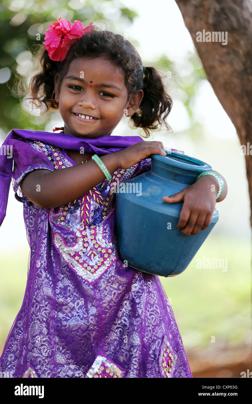 Young Indian girl carrying a little water pot Andhra Pradesh South India - Stock Image